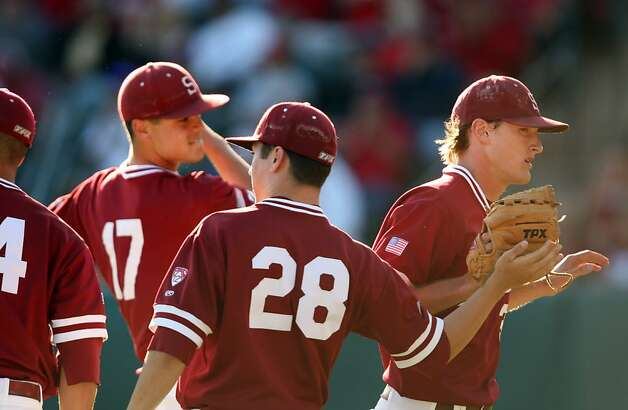 Brett Mooneyham returns to the dugout after being replaced on the mound on Saturday. Stanford met Pepperdine at Sunken Diamond on Saturday for the 2nd NCAA Regional game. Photo: Kevin Johnson, The Chronicle