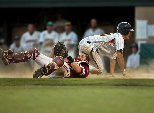 Pepperdine's Bryan Langlois dives for home plate but is denied by Stanford's catcher Eric Smith. Stanford met Pepperdine at Sunken Diamond on Saturday for the 2nd NCAA Regional game. Photo: Kevin Johnson, The Chronicle