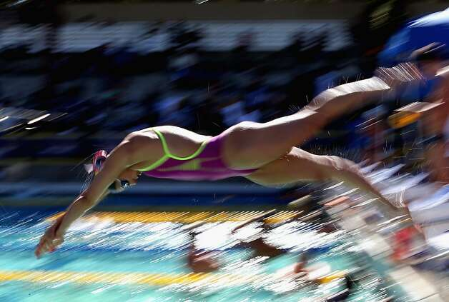 SANTA CLARA, CA - JUNE 02:  Stephanie Rice of Australia dives in during a training session on day 3 of the Santa Clara International Grand Prix at George F. Haines International Swim Center on June 2, 2012 in Santa Clara, California.  (Photo by Ezra Shaw/Getty Images) Photo: Ezra Shaw, Getty Images