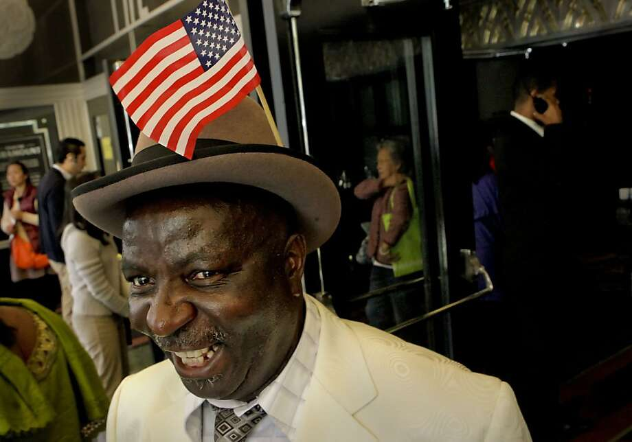 Sebastian Ita, of Nigeria, is all smiles after joining 1,209 people who took the oath of US citizenship at the Paramount Theater on Wednesday May 30, 2012, in Oakland, Ca. Photo: Michael Macor, The Chronicle