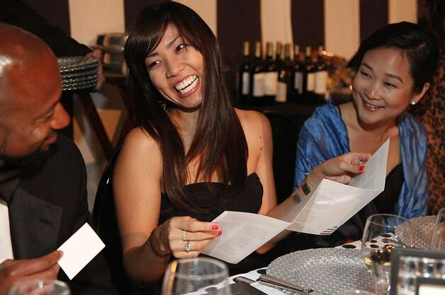 Lori Honda (center) laughs with Jim Harris and Sarah Sasaki at the Black and White Ball celebrating the 100th Anniversary of the San Francisco Symphony on Saturday, June 2, 2012. Photo: Alex Washburn
