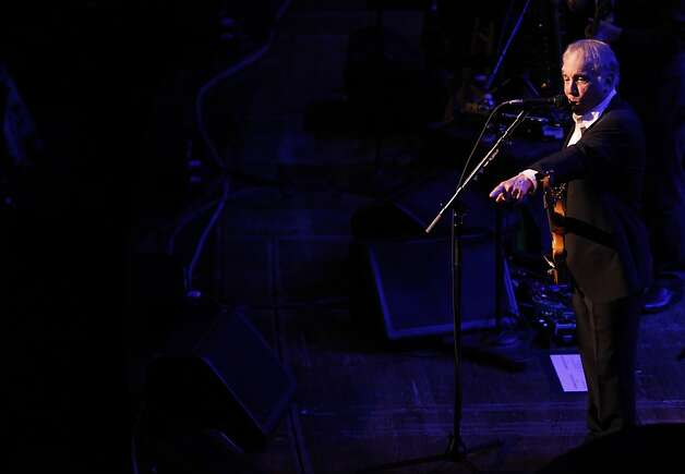 Paul Simon sings 'Diamonds on the soles of her shoes' while pointing to a woman with diamond soled shoes during the Black and White Ball celebrating the 100th Anniversary of the San Francisco Symphony on Saturday, June 2, 2012. Simon told the audience 'this has never happened before' in reference to the footwear of the woman in the front row. Photo: Alex Washburn