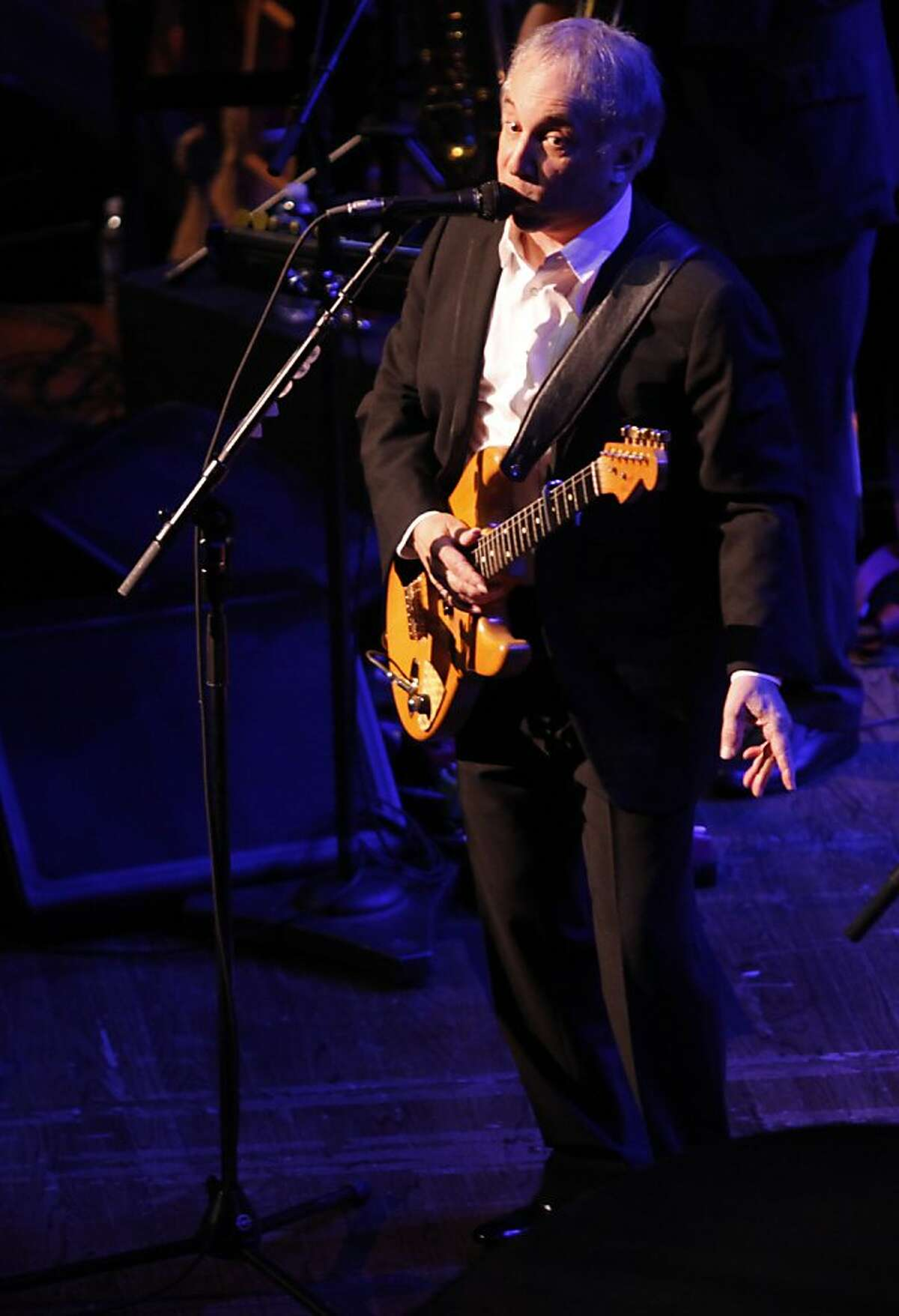 Paul Simon sings 'Diamonds on the soles of her shoes' to a crowd at the Black and White Ball celebrating the 100th Anniversary of the San Francisco Symphony on Saturday, June 2, 2012.