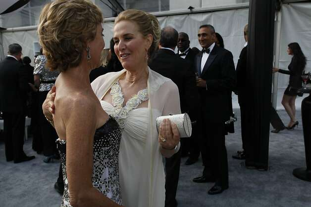 Marcia and Lisa Goldman (left to right)  greet each other at the Black and White Ball celebrating the 100th Anniversary of the San Francisco Symphony on Saturday, June 2, 2012. Photo: Alex Washburn