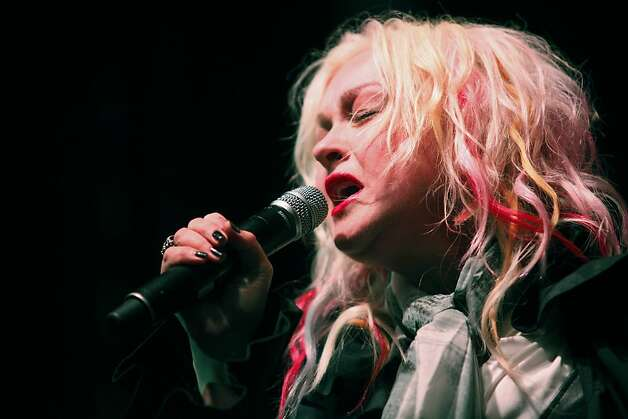 Cyndi Lauper gets bluesy for San Francisco during the Black and White Ball celebrating the 100th Anniversary of the San Francisco Symphony on Saturday, June 2, 2012. She finished her set with a modern rendition of none-other than 'Girls Just Wanna Have Fun' which sent the audience into over drive. Photo: Alex Washburn