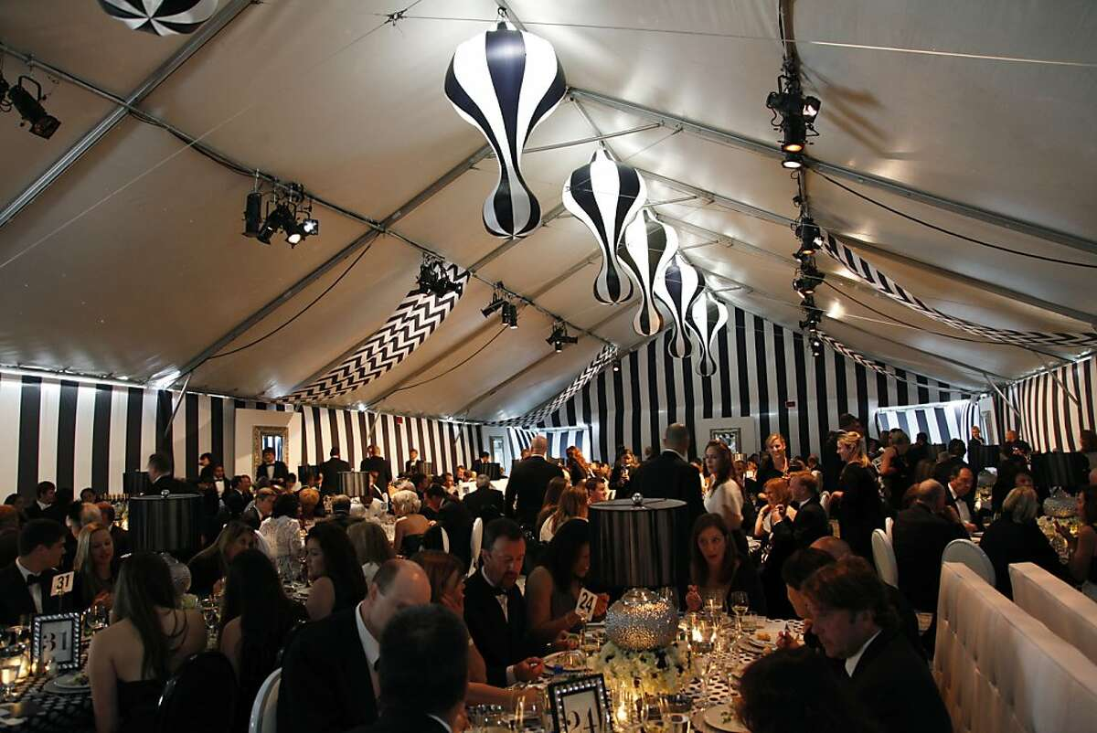 Guests mingle over fine food and elaborate centerpieces at the Black and White Ball celebrating the 100th Anniversary of the San Francisco Symphony on Saturday, June 2, 2012.