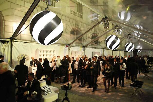 VIPs mingle near the patrons' tent at the Black and White Ball celebrating the 100th Anniversary of the San Francisco Symphony on Saturday, June 2, 2012. Photo: Alex Washburn