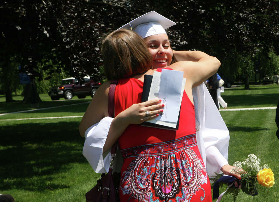 Fallon Foster, of Trumbull, gets a hug from her mother, Sara, after graduating from Lauralton Hall on Sunday, June 3, 2012 in Milford, Conn. Photo: B.K. Angeletti / Connecticut Post