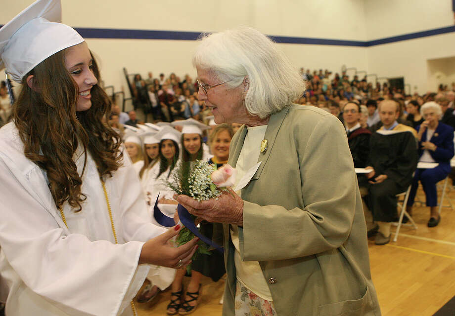 Lauralton Hall graduate Brooke Buynak, of Shelton, presents alumna Francis Dwyer, of West Haven, with flowers at commencement exercises on Sunday, June 3, 2012 in Milford, Conn. Photo: B.K. Angeletti / Connecticut Post