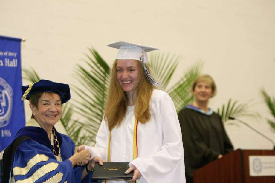 Katherine Fredericks receives her diploma during Lauralton Hall's commencement exercises on Sunday, June 3, 2012 in Milford, Conn. Photo: B.K. Angeletti / Connecticut Post
