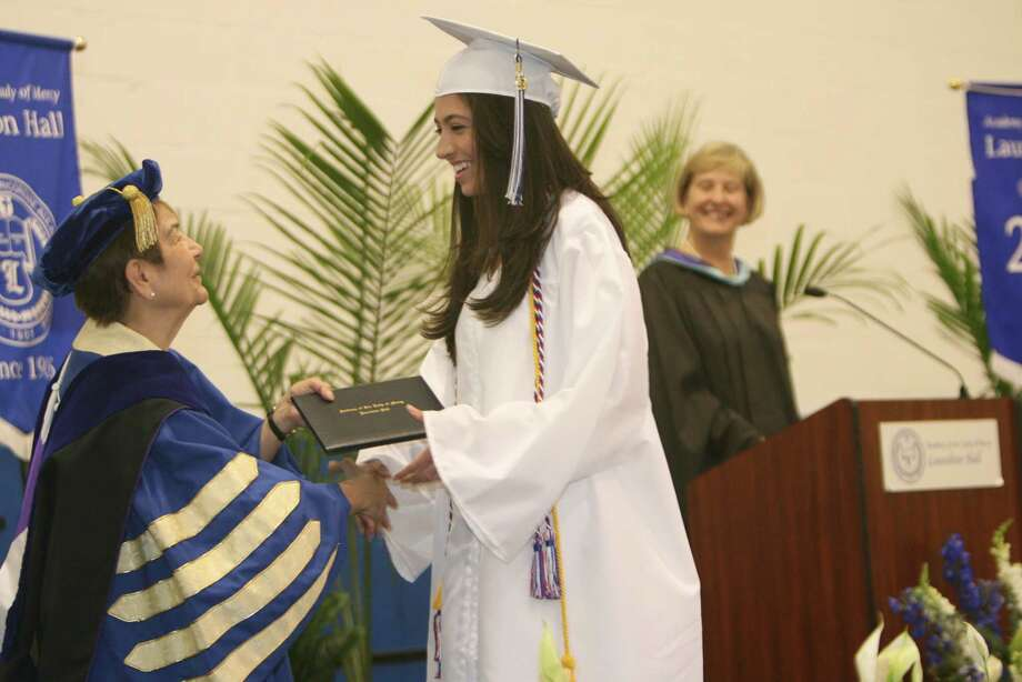 Luisa Duque, of Norwalk, receives her diploma during Lauralton Hall's commencement exercises on Sunday, June 3, 2012 in Milford, Conn. Photo: B.K. Angeletti / Connecticut Post