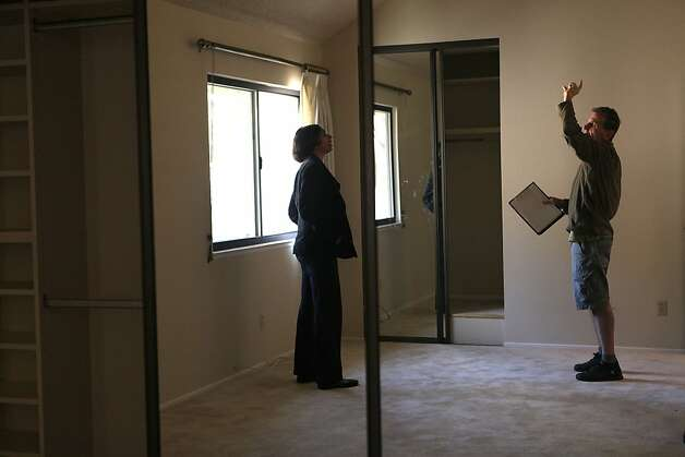 Buyer  Suhasini N. Ram (left) looking at possible updates to the home   with contractor Bill Sullivan (right) in Sunnyvale, Calif.,  on Tuesday, May 15, 2012.  Suhasini and her husband beat out 14 other buyers in a multiple offer a few weeks ago, buying this townhome for 725K. Photo: Liz Hafalia, The Chronicle