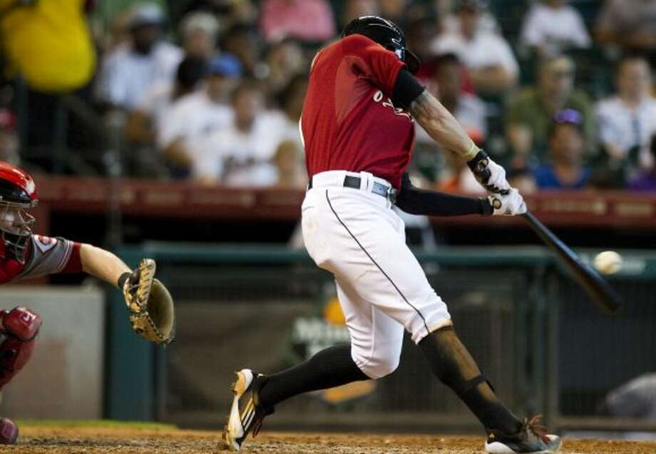 Astros center fielder Jordan Schafer hits an RBI sacrifice fly to right field, driving home Jason Castro. (Brett Coomer / Chronicle)