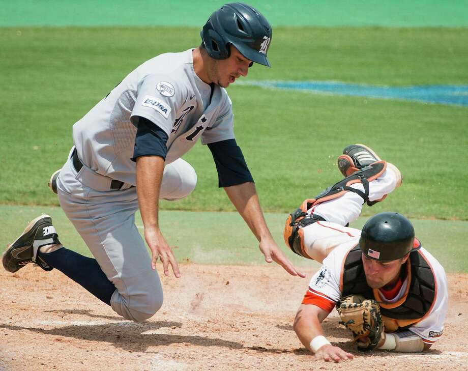 Rice's J.T. Chargois is out at home in a collision with Sam Houston State catcher John Hale during the fifth inning of an NCAA college baseball tournament regional game Sunday, June 3, 2012, in Houston. Sam Houston State won 4-1, eliminating Rice from the tournament. Photo: Smiley N. Pool, Houston Chronicle / © 2012  Houston Chronicle