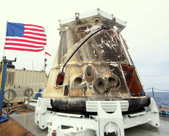 This photo provided by SpaceX shows the Dragon spacecraft on a boat in the Pacific Ocean on Thursday, May 31, 2012. Triumphant from start to finish, the Dragon parachuted into the Pacific on Thursday to conclude the first private delivery to the International Space Station and inaugurate NASA's new approach to exploration. Photo: AP