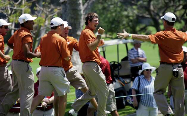 Texas senior Dylan Frittelli pumps his fist and celebrates with his team after sinking a long birdie putt on No. 18 to clinch the Longhorns' third NCAA men's golf championship. Photo: Reed Saxon, Associated Press