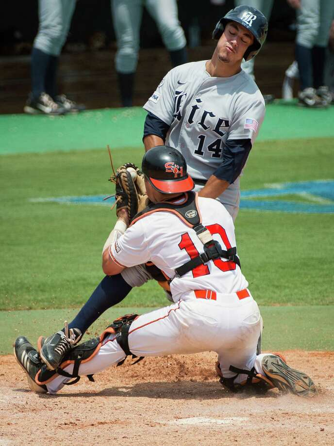 Rice's J.T. Chargois is tagged out at home by Sam Houston State catcher John Hale. SHSU eliminated Rice 4-1. Photo: Smiley N. Pool, Houston Chronicle