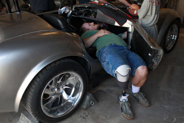 Chris Leverkuhn, who was injured in Iraq, works to get the Cobra he and other soldiers built with the Automotivation program running at Lay'N Color in Converse on May 25, 2012 in preparation for taking it to the Helotes Memorial Day Car Show. Photo: Lisa Krantz, San Antonio Express-News / San Antonio Express-News