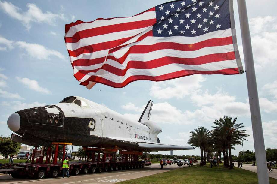 A full-size replica of the space shuttle is slowly moved down Nasa Road 1 to Space Center Houston, Sunday, June 3, 2012, in Houston.