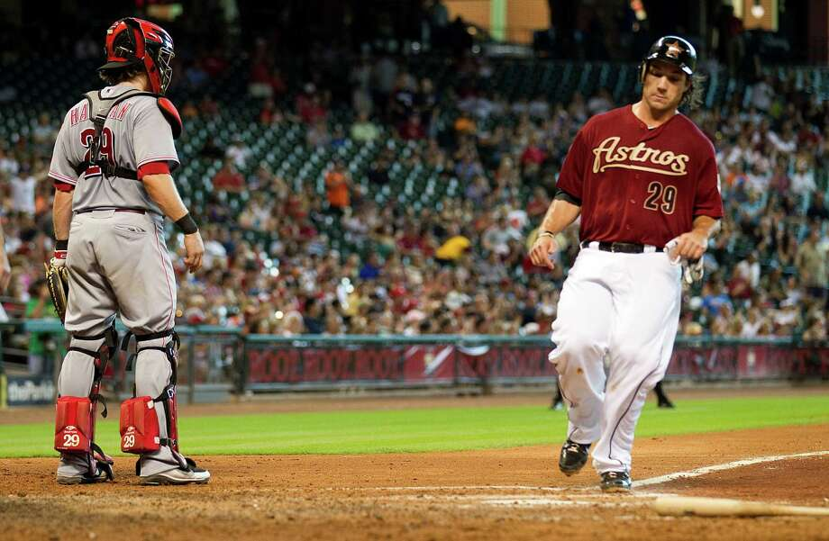 Houston Astros first baseman Brett Wallace (29) scores on a single by Marwin Gonzalez as Cincinnati Reds catcher Ryan Hanigan (29) stands by during the fifth inning of a major league baseball game at Minute Maid Park Sunday, June 3, 2012, in Houston. Photo: Brett Coomer, Chronicle / © 2012 Houston Chronicle