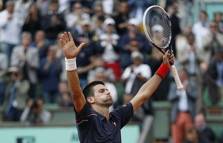 Serbia's Novak Djokovic celebrates after winning against Italy's Andreas Seppi their Men's Singles 4th Round tennis match of the French Open tennis tournament at the Roland Garros stadium, on June 3, 2012 in Paris.    AFP PHOTO / THOMAS COEXTHOMAS COEX/AFP/GettyImages Photo: Thomas Coex, AFP/Getty Images