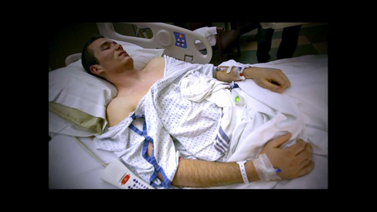 Colin Goddard recovers in the hospital after being shot four times in the 2007 Virginia Tech rampage - in both hips, his armpit and his right shoulder.