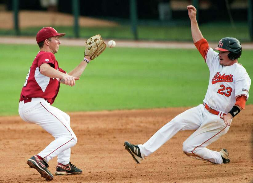 Sam Houston State's Jake Arrington (23) is caught stealing as Arkansas shortstop Derrick Bleeker tak