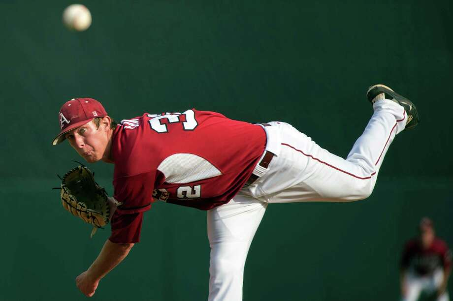 Arkansas pitcher Randall Fant delivers against Sam Houston State during the first inning of an NCAA college baseball tournament regional game, Sunday, June 3, 2012, in Houston. (AP Photo/Houston Chronicle, Smiley N. Pool) MANDATORY CREDIT Photo: Smiley N. Pool, Associated Press / © 2012  Houston Chronicle