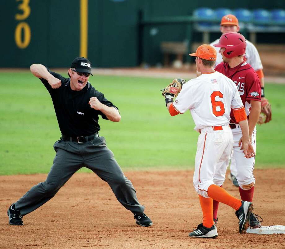 Umpire Jake Uhlenhopp, left, makes the call as Sam Houston State shortstop Corey Toups (6) show the ball is secure in his glove after Arkansas' Joe Serrano was picked off second base during the third inning of an NCAA college baseball tournament regional game, Sunday, June 3, 2012, in Houston. (AP Photo/Houston Chronicle, Smiley N. Pool)  MANDATORY CREDIT Photo: Smiley N. Pool, Associated Press / © 2012  Houston Chronicle