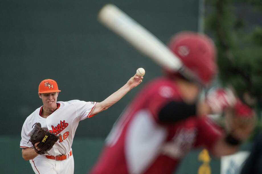 Sam Houston State pitcher Cody Dickson delivers a pitch during the fourth inning of an NCAA college baseball tournament regional game against Arkansas on Sunday, June 3, 2012, in Houston. Photo: Smiley N. Pool, Houston Chronicle / © 2012  Houston Chronicle