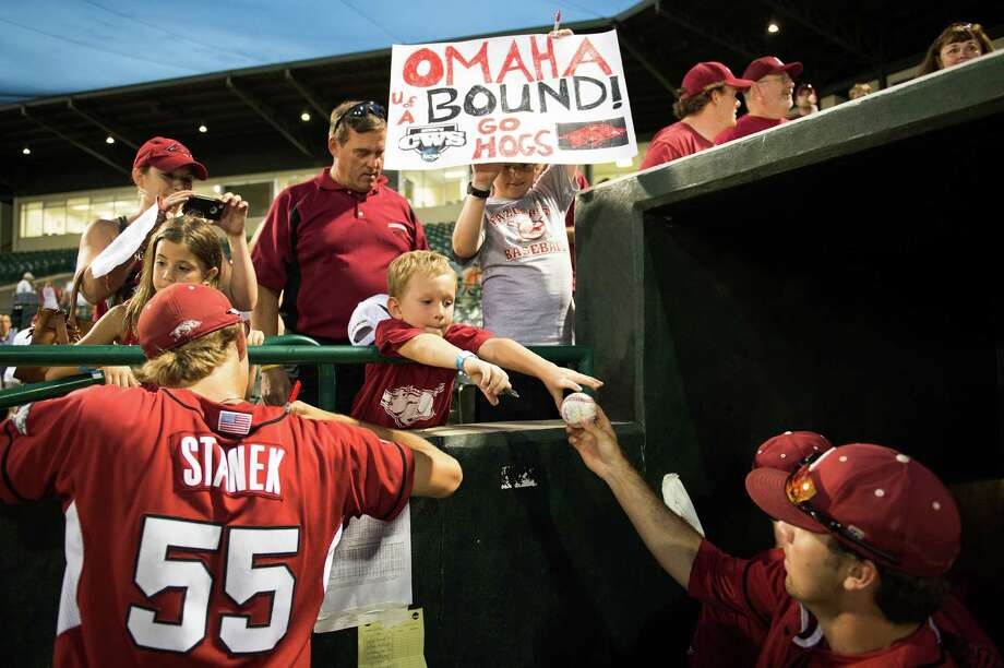 Arkansas pitcher Ryne Stanek (55) and infielder Jacob Mahan, right, sign autographs for fans after their victory over Sam Houston State after an NCAA college baseball tournament regional game Sunday, June 3, 2012, in Houston. Arkansas won the game 5-1 to win the regional. Photo: Smiley N. Pool, Houston Chronicle / © 2012  Houston Chronicle