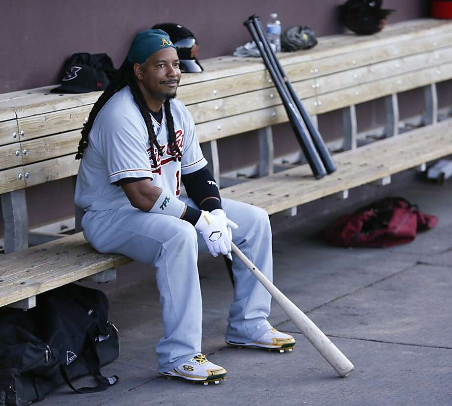 Manny Ramirez, of the Sacramento RiverCats, sits in the visiting team dugout before a Triple-A baseball game against the Albuquerque Isotopes in Albuquerque, N.M., Saturday, May 19, 2012. In advance of being activated from his 50-game suspension, Ramirez is scheduled to play 10 games with Sacramento before returning to the Oakland Athletics. (AP Photo/Jake Schoellkopf) Photo: Jake Schoellkopf, Associated Press