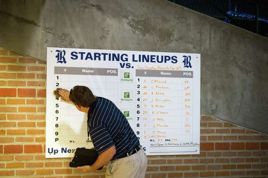 An official erases the lineups from a display board at Reckling Park following the final NCAA college baseball tournament regional game on Sunday, June 3, 2012, in Houston. The host Rice Owls season ended with a loss to Sam Houston State earlier in the day and Arkansas won the final game over SHSU 5-1 to win the regional. Photo: Smiley N. Pool, Houston Chronicle / © 2012  Houston Chronicle
