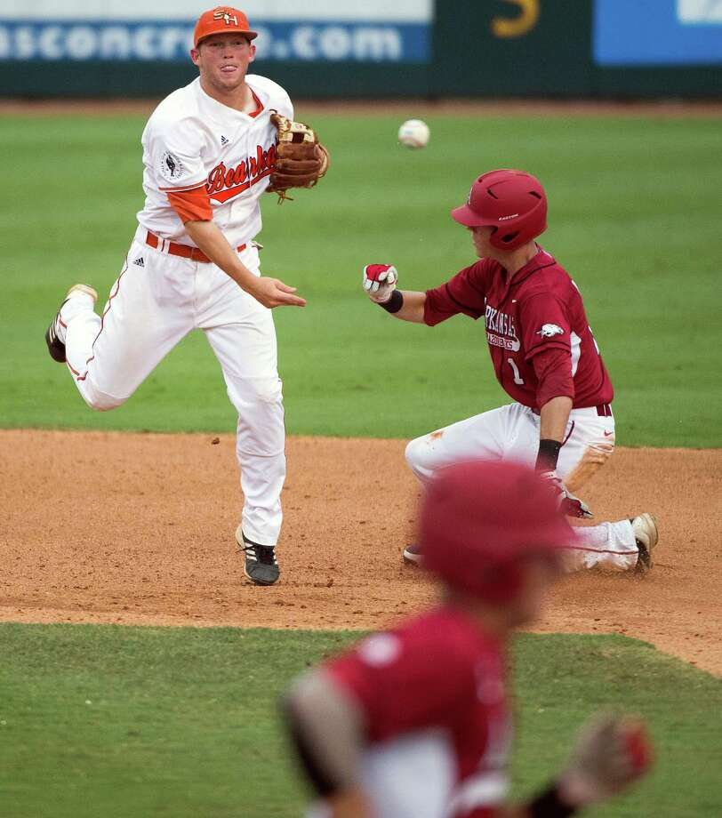 Sam Houston State shortstop Corey Toups makes the relay over Arkansas' Brian Anderson but can't get the double play on hitter Bo Bigham, bottom, as he commits a throwing error during the fifth inning of an NCAA college baseball tournament regional game Sunday, June 3, 2012, in Houston. Arkansas won the game 5-1 to win the regional. Photo: Smiley N. Pool, Houston Chronicle / © 2012  Houston Chronicle