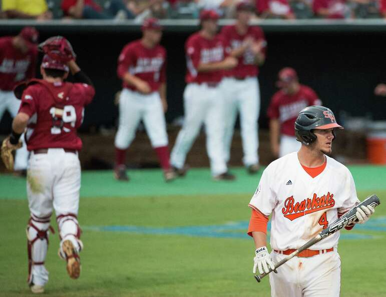 Sam Houston State third baseman Kevin Miller (4) reacts after striking out to end the seventh inning