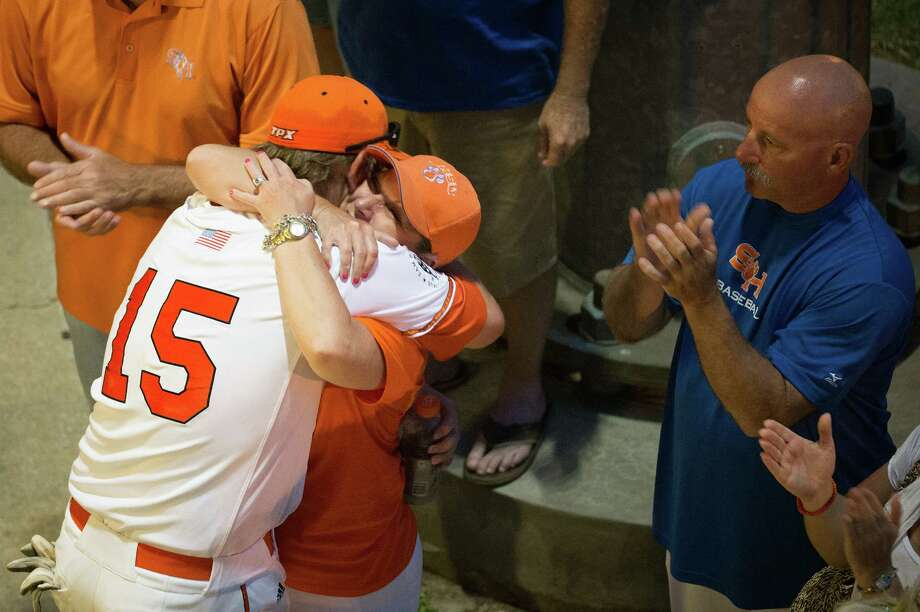Sam Houston State first baseman Jordan Bunch (15) gets a hug from his mother Jeree after the Bearkats lost to Arkansas in an NCAA college baseball tournament regional game Sunday, June 3, 2012, in Houston. Arkansas won the game 5-1 to win the regional. Photo: Smiley N. Pool, Houston Chronicle / © 2012  Houston Chronicle