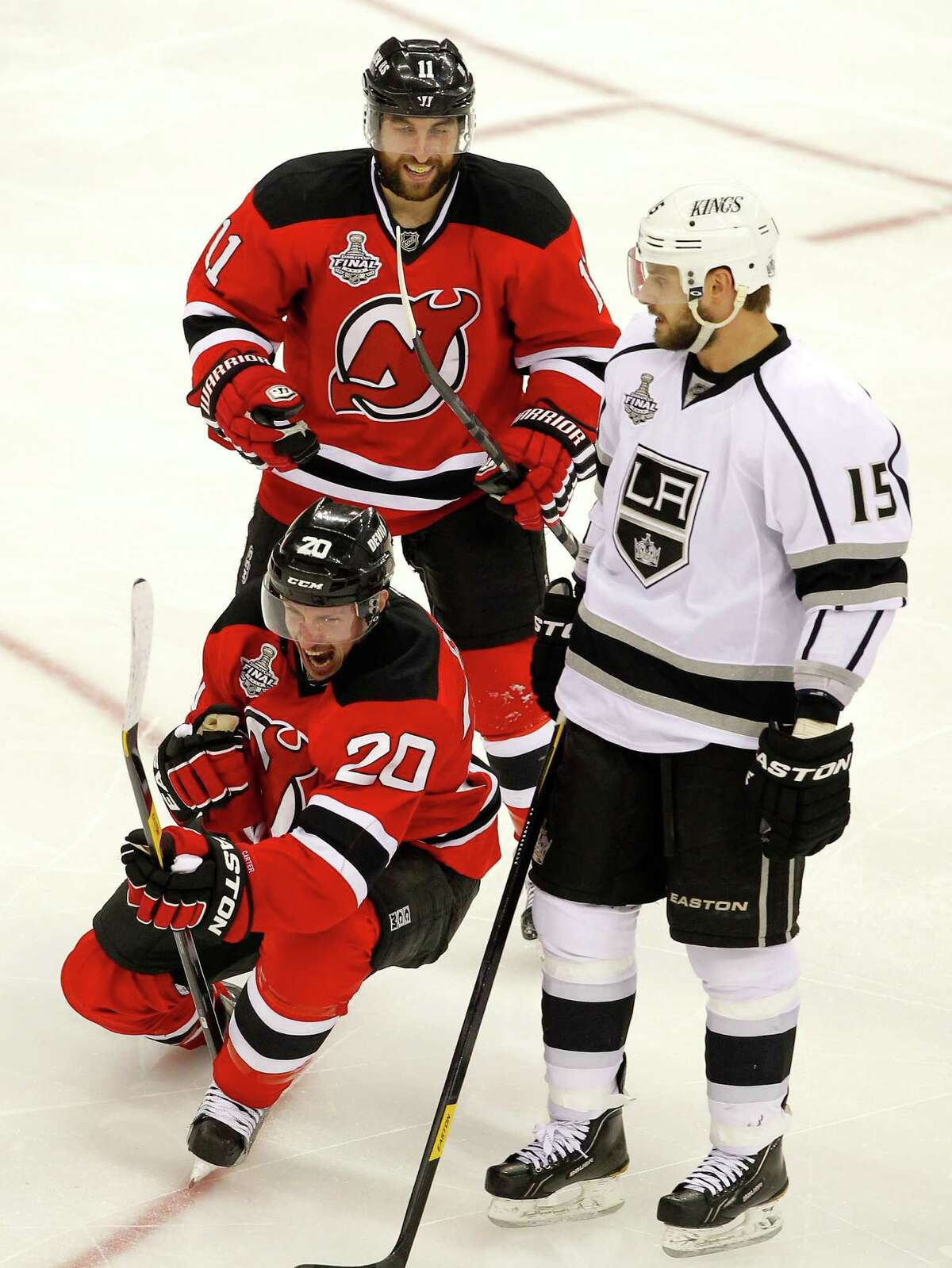NEWARK, NJ - JUNE 02: Ryan Carter #20 of the New Jersey Devils celebrates after scoring a goal in the third period with Stephen Gionta #11 as Brad Richardson #15 of the Los Angeles Kings looks on during Game Two of the 2012 NHL Stanley Cup Final at the Prudential Center on June 2, 2012 in Newark, New Jersey. (Photo by Paul Bereswill/Getty Images)
