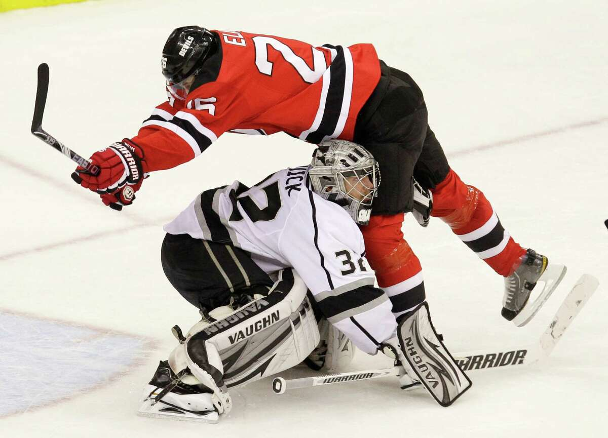 New Jersey Devils' Patrik Elias, top, of the Czech Republic, falls over Los Angeles Kings' goalie Jonathan Quick during the third period of Game 2 of the NHL hockey Stanley Cup finals on Saturday, June 2, 2012, in Newark, N.J. (AP Photo/Kathy Willens)