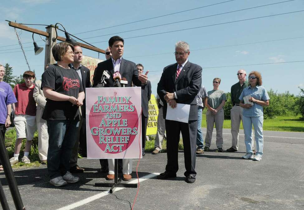 Assemblyman George Amedore, center, addresses those gathered during a press event at Riverview Orchards on Sunday, June 3, 2012 in Rexford, NY. Also pictured from left is Isabel Prescott, owner of the orchards, Assemblyman Pete Lopez, Senator Hugh Farley and Assemblyman Jim Tedisco. The event was held by legislators to announce new legislation, the ?Family Farmers and Apple Growers Relief Act? to help apple growers and farmers who have lost a significant amount of their crops due to the extreme weather. Isabel Prescott, owner of Riverview Orchards said that she's projecting that over 75% of their apple crop is lost due to weather. (Paul Buckowski / Times Union)