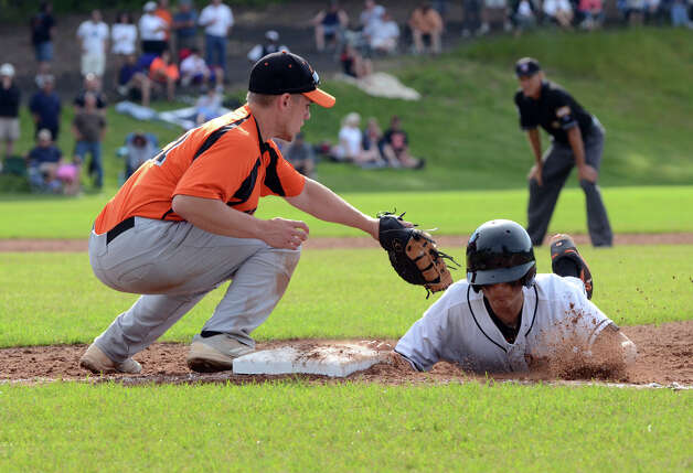 Ridgefield's Adam Zandri (28) hits the bag as Shelton's Ryan Daiss (21) goes for the tag during the Class LL baseball quarterfinals at Shelton High School on Sunday, June 3, 2012. Photo: Amy Mortensen / Connecticut Post Freelance