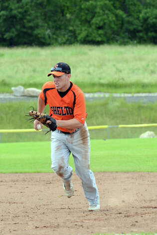 Shelton's Ryan Daiss (21) makes a play during the Class LL baseball quarterfinals against Ridgefield at Shelton High School on Sunday, June 3, 2012. Photo: Amy Mortensen / Connecticut Post Freelance