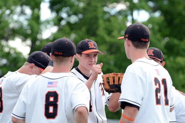 Ridgefield's Ryan Debany, center, meets in a huddle during the Class LL baseball quarterfinals against Shelton at Shelton High School on Sunday, June 3, 2012. Photo: Amy Mortensen / Connecticut Post Freelance