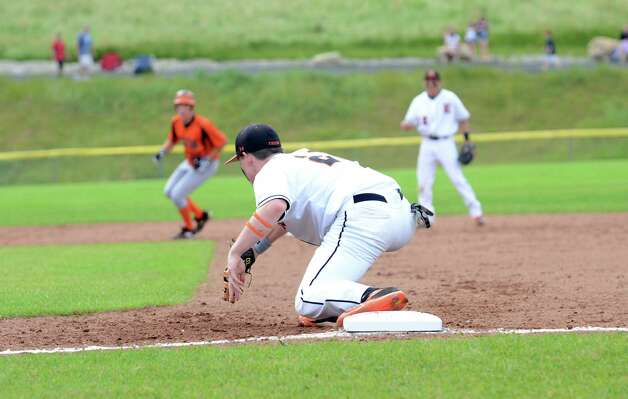 Ridgefield's Patrick Molyneaux (21) at first base during the Class LL baseball quarterfinals against Shelton at Shelton High School on Sunday, June 3, 2012. Photo: Amy Mortensen / Connecticut Post Freelance