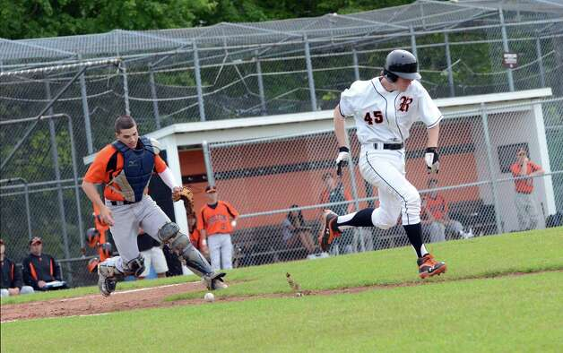 Ridgefield's Christopher McClelland (45) runs to first as Shelton's catcher Bryan Kondor (20) goes after the ball during the Class LL baseball quarterfinals against Shelton at Shelton High School on Sunday, June 3, 2012. Photo: Amy Mortensen / Connecticut Post Freelance