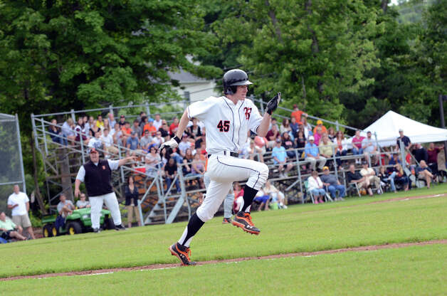 Ridgefield's Christopher McClelland (45) runs to first during the Class LL baseball quarterfinals against Shelton at Shelton High School on Sunday, June 3, 2012. Photo: Amy Mortensen / Connecticut Post Freelance