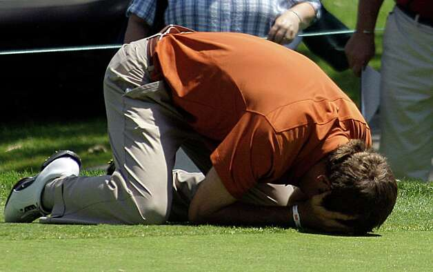 Dylan Frittelli falls to the ground after making the winning putt as the University of Texas men's golf team celebrated their victory over Alabama in the NCAA Division 1 golf championship at Riviera Country Club in Los Angeles, Sunday, June 3, 2012. Photo: Reed Saxon, Associated Press
