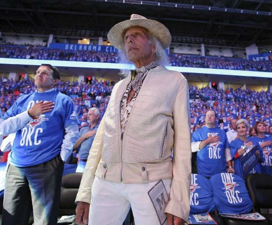 James Goldstein, standing during the national anthem before Game 3 of the Western Conference Finals on May 31, 2012, has been a courtside figure in arenas for decades. He's beloved by the NBA world because of his love for the game.  (Edward A. Ornelas / San Antonio Express-News)