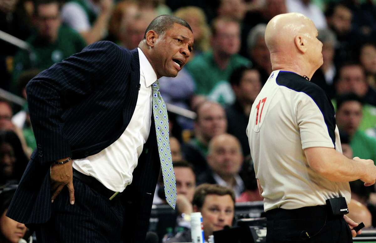 Boston Celtics head coach Doc Rivers, left, questions referee Joe Crawford (17) during the first quarter of Game 4 against the Miami Heat in their NBA basketball Eastern Conference finals playoff series in Boston, Sunday, June 3, 2012.