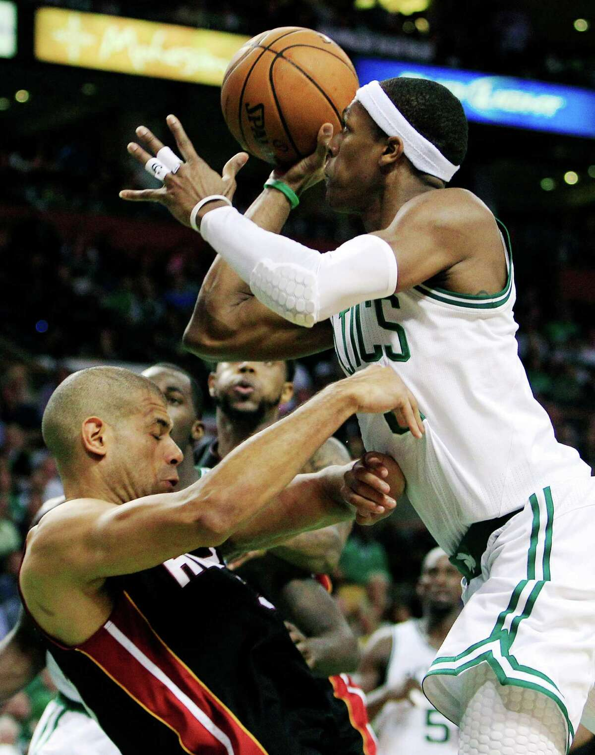 Boston Celtics guard Rajon Rondo, right, shoots over Miami Heat forward Shane Battier, left, during the second quarter of Game 4 in their NBA basketball Eastern Conference finals playoff series in Boston, Sunday, June 3, 2012.