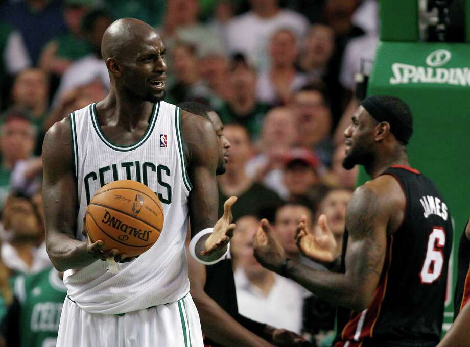 Boston Celtics forward Kevin Garnett, left, and Miami Heat forward LeBron James (6) react during the fourth quarter of Game 4 in their NBA basketball Eastern Conference finals playoff series in Boston Sunday, June 3, 2012. Boston won 93-91 in overtime to even the series at two games each. (AP Photo/Elise Amendola) Photo: Elise Amendola, Associated Press / AP